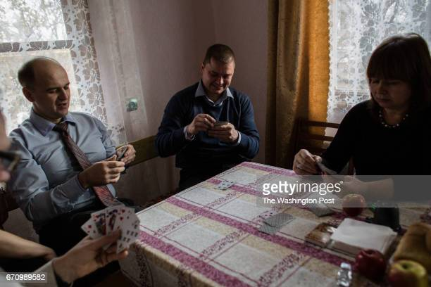 Defendants play cards during the break between the hearings 16 Jehovah's Witnesses are accused of extremist activity in Taganrog Russia