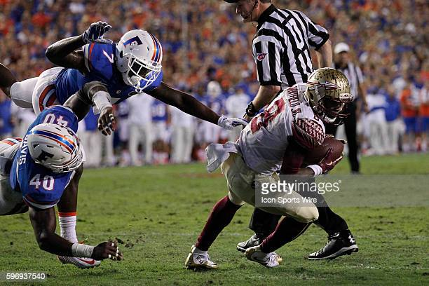 Florida State Seminoles wide receiver Kermit Whitfield is brought down at the 1 yard line by Florida Gators linebacker Jarrad Davis and Florida...