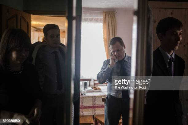 From left to right Defendants Tatyana and Kirill Kravchenko Vladimir Kozhuhov and Roman Volostshiuk arrive to their friend's house for lunch during...