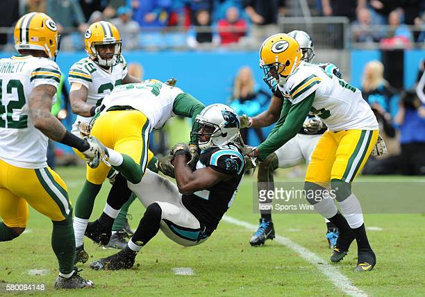 Green Bay Packers strong safety Micah Hyde tries to strip the ball loose as Carolina Panthers wide receiver Jerricho Cotchery goes to the ground...