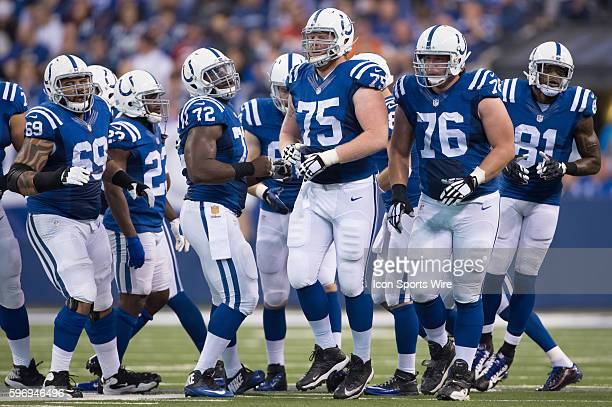 Indianapolis Colts Offensive Tackle Jack Mewhort [11184], Indianapolis Colts Offensive Tackle Joe Reitz [6637] and teammates in action during a game...