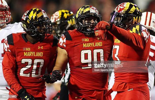 Maryland Terrapins defensive lineman Oseh Saine , Maryland Terrapins defensive back Anthony Nixon , and Maryland Terrapins defensive lineman Roman...