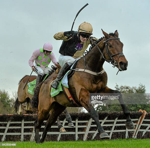 15 November 2015 Nicholas Canyon with David Mullins up clears the last ahead of Faugheen with Ruby Walsh up on their way to winning the StanJamescom...