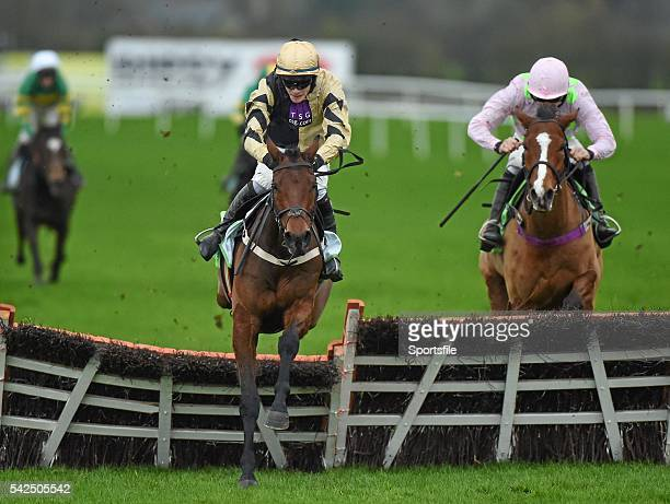 15 November 2015 Nicholas Canyon with David Mullins up jump the last on their way to winning the StanJamescom Morgiana Hurdle from second place...