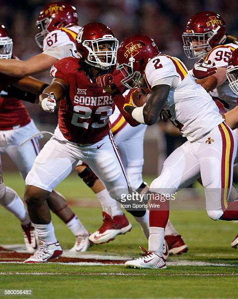 Oklahoma Sooner linebacker Devante Bond looks to tackle Iowa State running back Mike Warren during the University of Oklahoma's game against the Iowa...