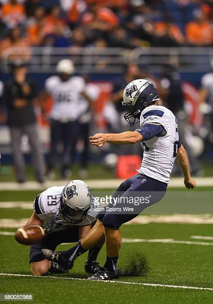 Old Dominion Monarchs place kicker Chris Kirtley kicks an extra point from the hold of holder Joseph Pulisic during an NCAA football game between the...