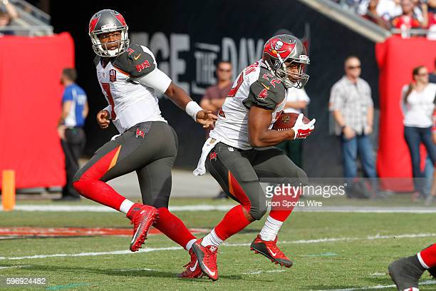 Tampa Bay Buccaneers quarterback Jameis Winston hands the ball off to Tampa Bay Buccaneers running back Doug Martin during the NFL game between the...