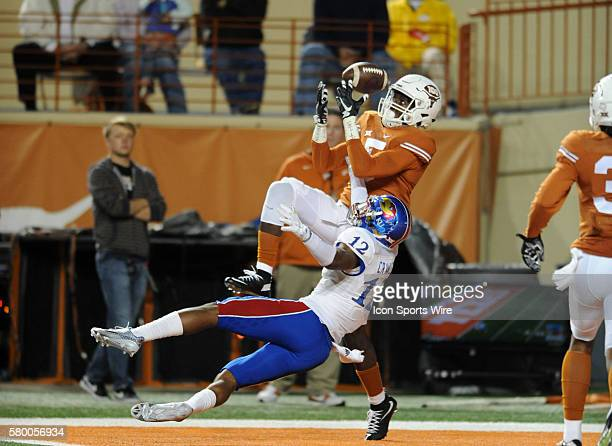 Texas CB Holton Hill attempts to intercept a pass as Darious Crawley tries to break it up during game against the Kansas Jayhawks at Darrell K...