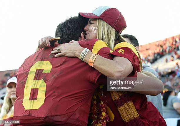 USC Cody Kessler hugs his mom Christie Kessler at the end of the game during an NCAA football game between the UCLA Bruins and the USC Trojans at the...