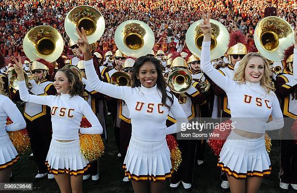 USC Trojans cheerleaders on the field after the Trojans defeated the UCLA Bruins 40 to 21 in a game played at the Los Angeles Memorial Coliseum in...