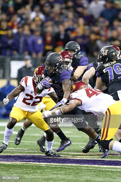 Washington's Lavon Coleman fights off USC defensive end Porter Gustin for extra yardage. USC defeated Washington 26-13 at Husky Stadium on November...