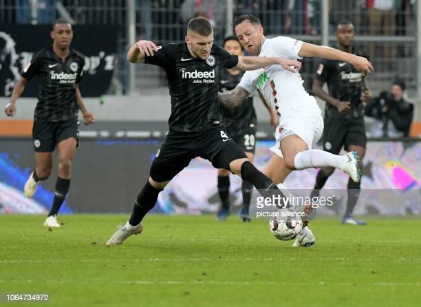 Soccer Bundesliga FC Augsburg Eintracht Frankfurt 12th matchday in the WWKArena Augsburg's Julian Schieber and Ante Rebic of Frankfurt fight for the...
