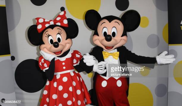 Minnie and Mickey Mouse celebrate their 90th anniversary Walt Disney's cartoon character celebrated its world premiere 90 years ago in the film...