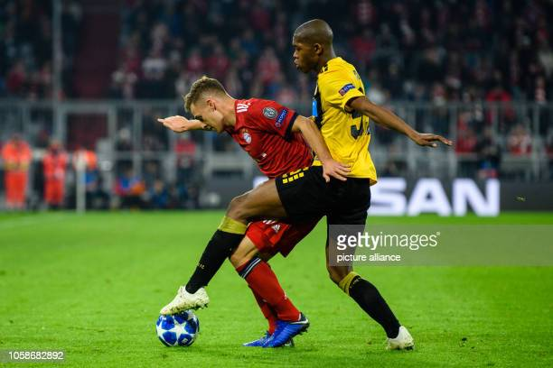 Soccer Champions League FC Bayern AEK Athens Group E Matchday 4 in the Allianz Arena Joshua Kimmich from FC Bayern Munich and Alef from Athens in the...