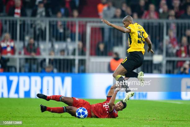 Soccer Champions League FC Bayern AEK Athens Group E Matchday 4 in the Allianz Arena Alef von Athen jumps in a duel over Serge Gnabry of FC Bayern...