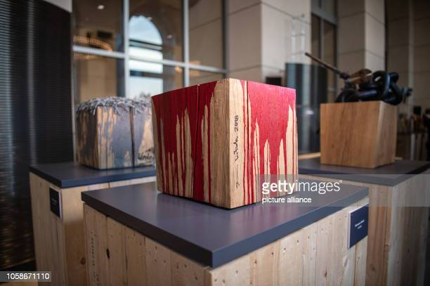 A wooden block painted with red acrylic paint by the Austrian artist Nitsch stands in the exhibition '1914/1918 Not Then Not Now Not Never' in the...