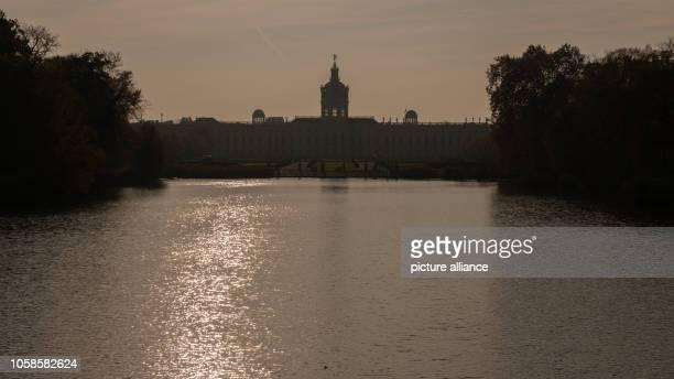 November 2018, Berlin: Charlottenburg Castle can be seen in the light of the sun. Photo: Paul Zinken/dpa/ZB
