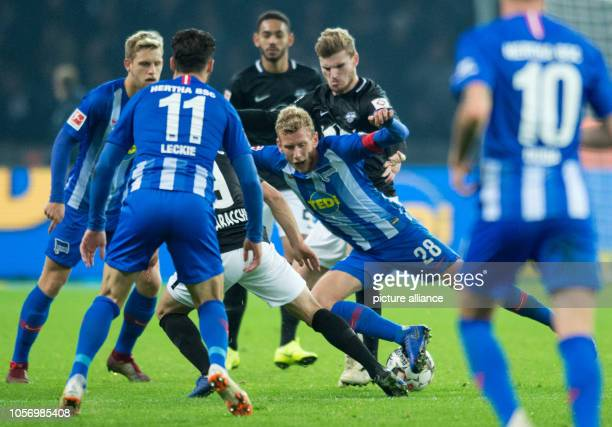 Football 1st Bundesliga 10th matchday Hertha BSC Berlin RB Leipzig in the Olympic Stadium Berlin's Fabian Lustenberger is attacked from behind by...