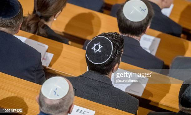 Guests wear Kippa at the Central Commemoration Event of the Central Council of Jews in Germany for the 80th anniversary of the Pogrom Night of 1938...