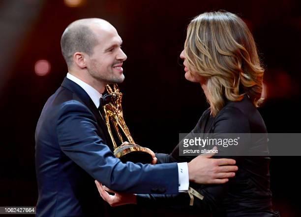 "November 2018, Berlin: Jessy Wellmer awards triathlete Patrick Lange at the 70th Bambi Media Prize in the category ""Special Jury Award"". Photo:..."