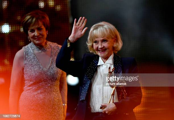 Liselotte Pulver is delighted to receive the Bambi Media Prize at the 70th ceremony for her life's work alongside laudator Paola Felix Photo Soeren...