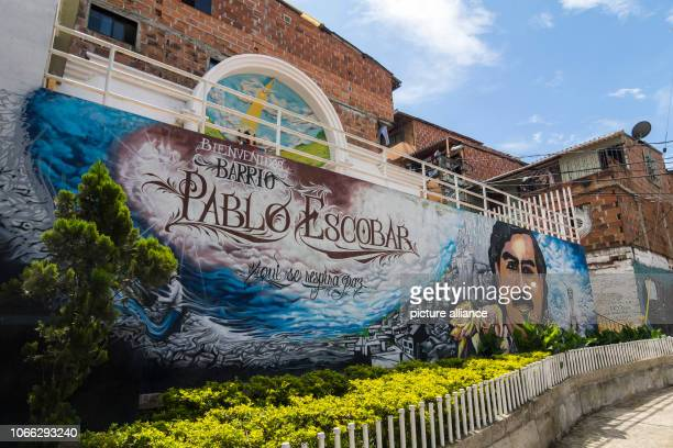Wall painting at the entrance of the Pablo Escobar quarter In Medellin metropolis of millions in the centre of the rich department Antioquia...