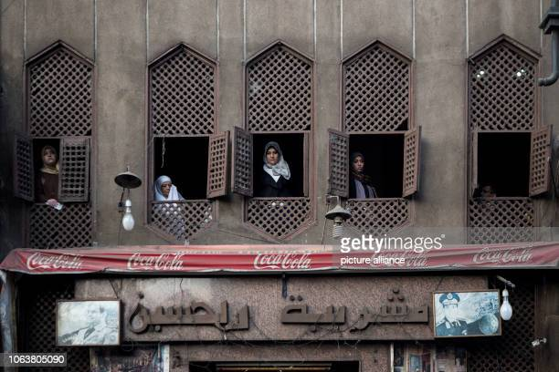 November 2018, Egypt, Cairo: Women look from windows to watch a Sufis march at Al Hussein district, to mark the Mawlid al-Nabi al-Sharif, an occasion...