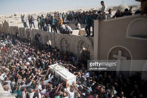 November 2018, Egypt, New Minya: People carry the coffin of Bishoy Reda Youssef, during his funeral at the Coptic graves after she was killed during...