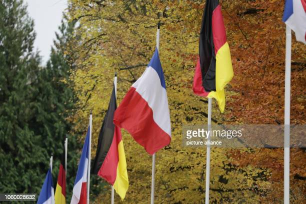 German and French flags are raised at the Glade of the Armistice near the city of Compiègne French President Macron and German chancelor Merkel will...