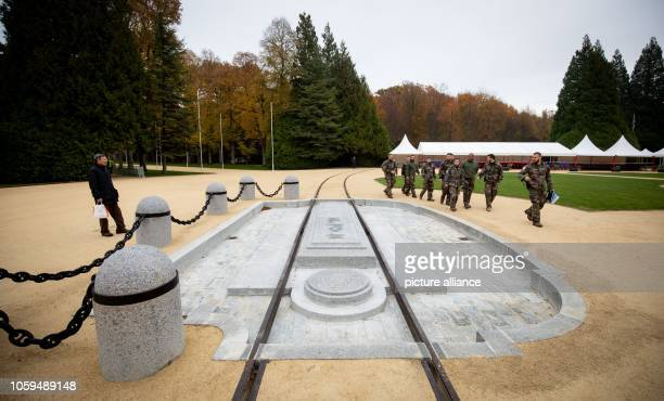 09 November 2018 France Compiègne France Compiègne French security forces pass through a clearing near Compiègne where the armistice was signed on in...