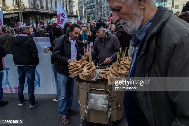 A member of a member union of the Communist Militant Workers Front buys a sesame ring before the start of a demonstration during a 24hour nationwide...