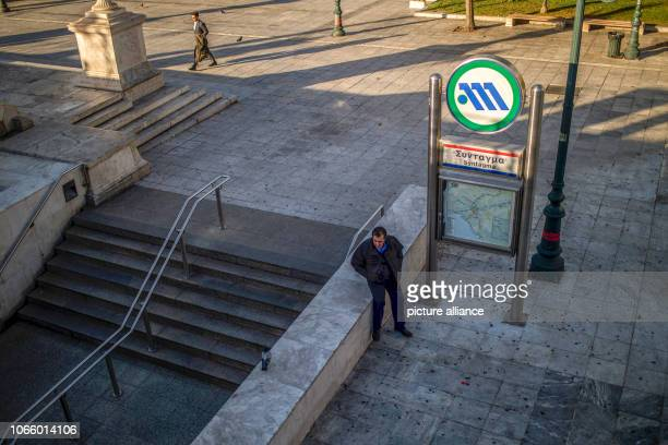 During a 24hour strike in Greece a man sits in front of the closed entrance to the metro The protest organised by GSEE the largest trade union for...