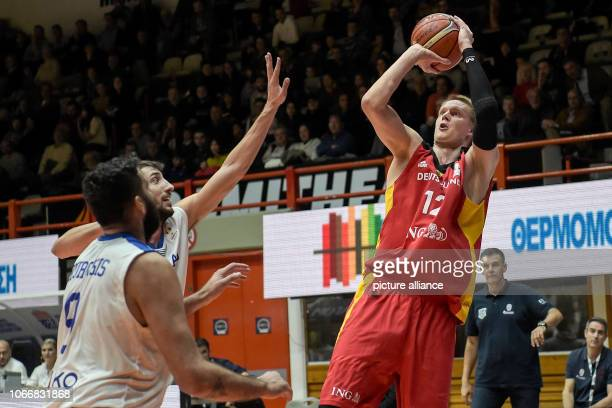 Basketball World Cup qualification Greece Germany Europe Round 2 Group L Matchday 3 German Robin Benzing wins against Greek Ioannis Bourousis Photo...