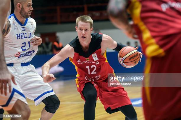 Basketball World Cup qualification Greece Germany Europe Round 2 Group L Matchday 3 German Robin Benzing on the ball Photo Angelos Tzortzinis/dpa