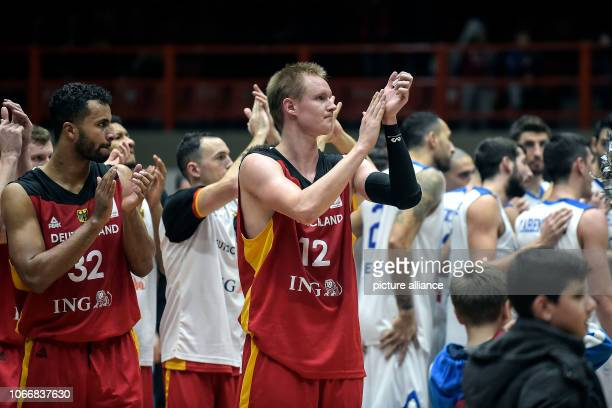 Basketball World Cup qualification Greece Germany Europe 2nd round Group L 3rd matchday The Germans Robin Benzing and Johannes Thiemann thank the...