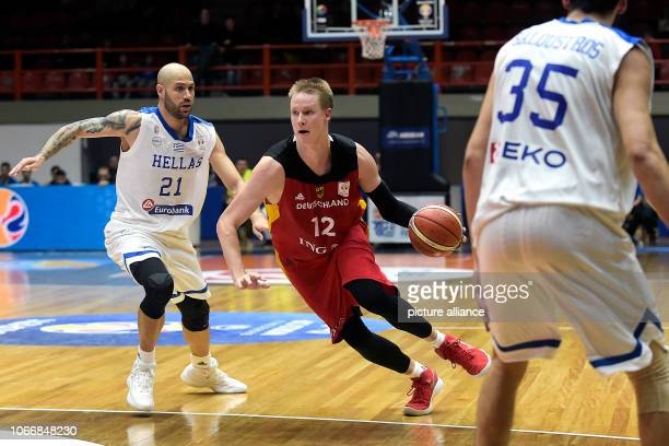Basketball World Cup qualification Greece Germany Europe Round 2 Group L Matchday 3 German Robin Benzing wins against Greek Panagiotis Vasilopoulos...