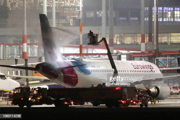 A Eurowings aircraft is deiced at temperatures below freezing at Hamburg Airport Photo Bodo Marks/dpa