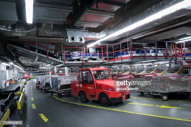 A vehicle with baggage containers passes the baggage conveyor system in Terminal 2 at Hamburg Airport Over the next few years Hamburg Airport will...