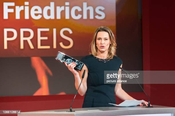 Anja Reschke television journalist holds the HannsJoachimFriedrichsPrize after her award The prize has been awarded annually since 1995 for...