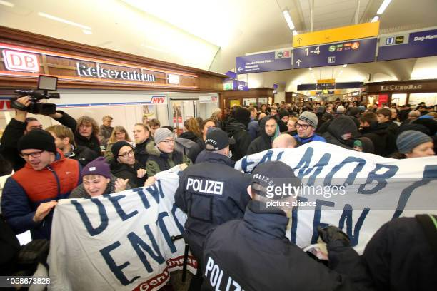 Counterdemonstrators of the event Merkel muss weg are pushed out of Dammtor station by the police with their banner Photo Bodo Marks/dpa