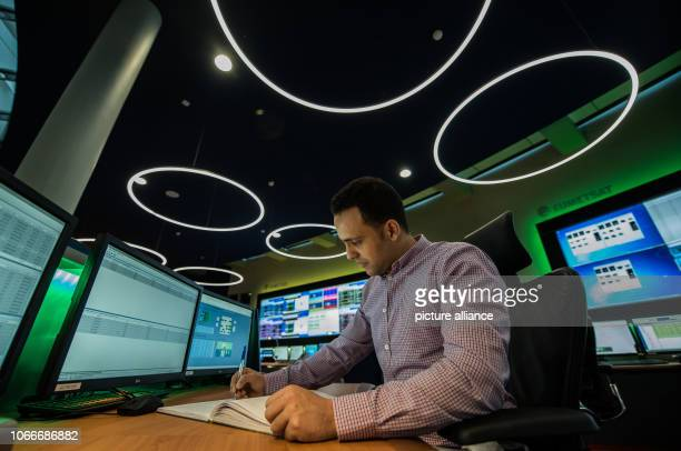 Amiri Mohammed Spacecraft controller sits in the new satellite control centre at his workplace and makes an entry in the logbook Eumetsat opens a new...