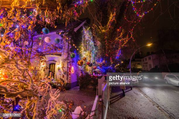A car drives past the illuminated Christmas house Christmas woman Christine as the 62yearold calls herself has been transforming the house and...
