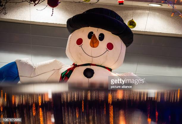 An illuminated snowman stands in front of the garage door Christmas woman Christine as the 62yearold calls herself has been transforming the house...