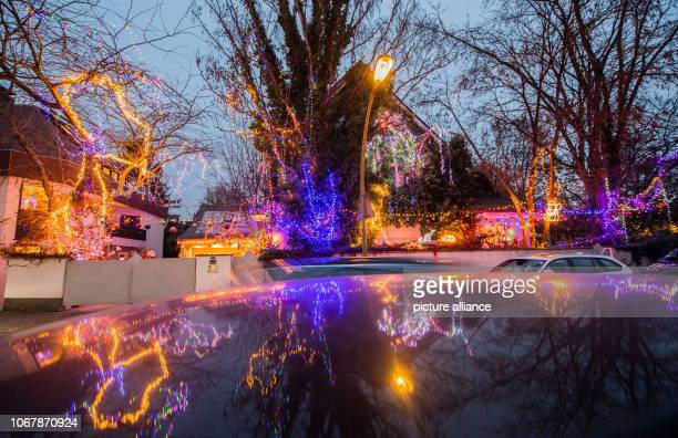 The Christmas illuminated house is reflected in a car roof Christmas woman Christine as the 62yearold calls herself has been transforming the house...