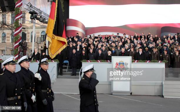 Bundeswehr soldiers march past the VIP stand with the German flag at the military parade for the 100th anniversary of the state Latvia celebrated its...