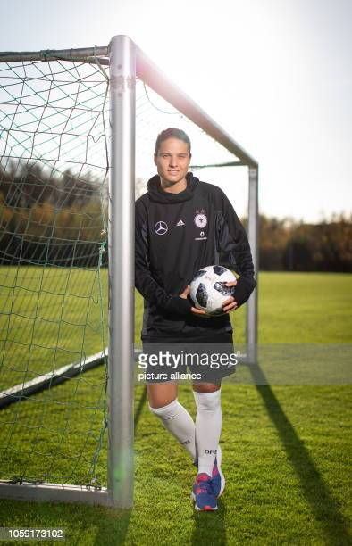 08 November 2018 North RhineWestphalia Harsewinkel National soccer player Dzsenifer Marozsan stands with a ball at a soccer goal on a training ground...
