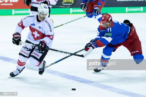 11 November 2018 North RhineWestphalia Krefeld Ice hockey Germany Cup Switzerland Russia 3rd matchday Swiss Jason Fuchs fights with Russia's...