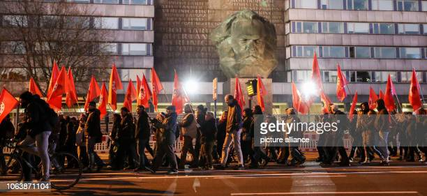 """November 2018, Saxony, Chemnitz: Participants of a right rally registered by the """"Merkeljugend"""" go through Chemnitz with flags in front of the..."""