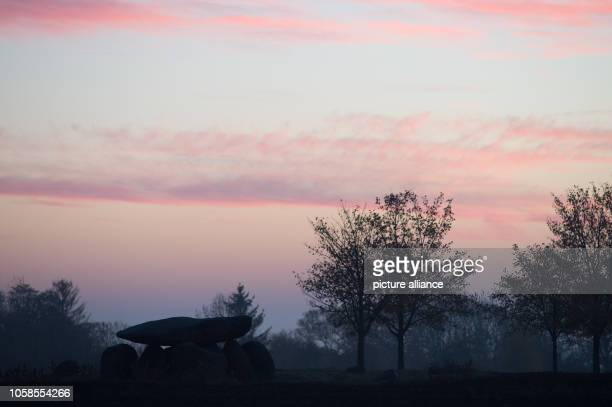 The morning dawns over the big stone grave Teufelskeller The grave dates from the Neolithic Age and was originally located under a mound of earth The...