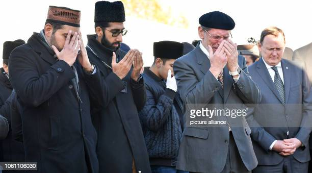 Bodo Ramelow Thuringia's Prime Minister stands next to parishioners praying together for a new mosque after the laying of the foundation stone The...